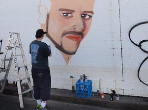 Chris Wilson painting a mural