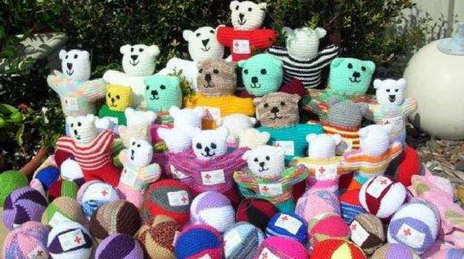 CUDDLY: Bears knitted by Red Cross volunteers.