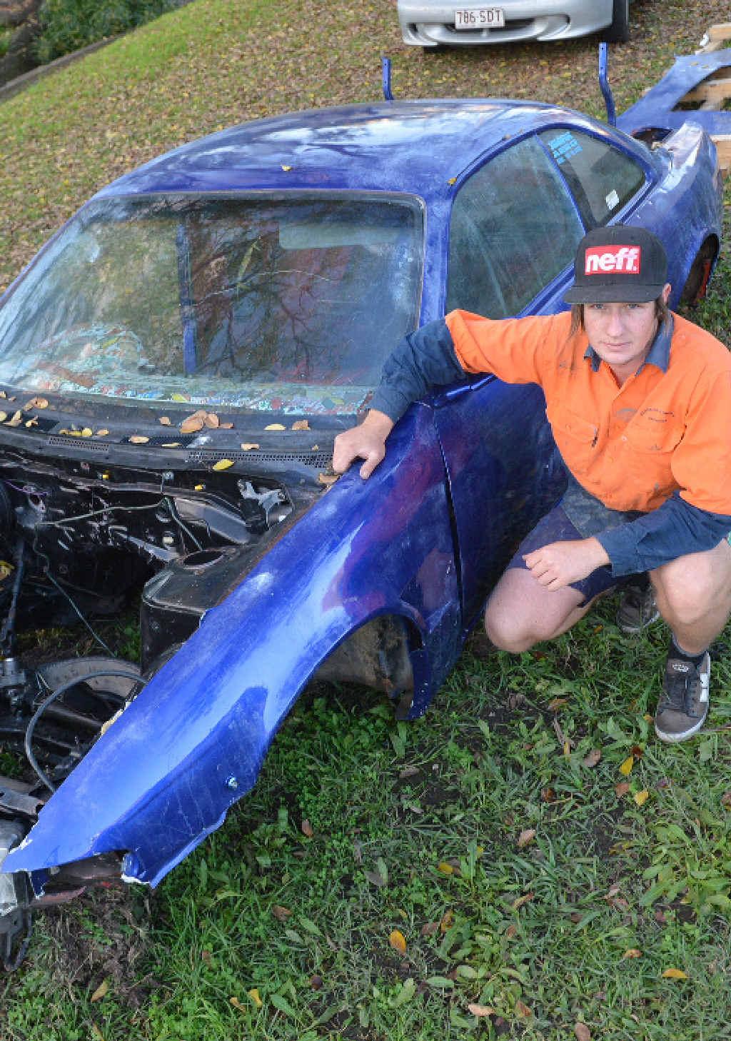 DREAMS DESTROYED: Patrick Barnes surveys all that is left of his dream drift car.