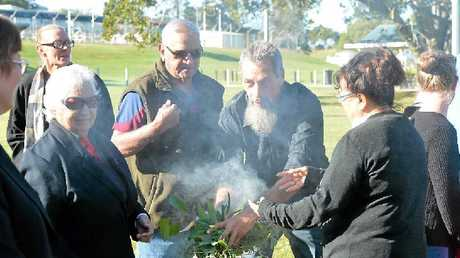 CLEANSING: Kev Starkey starts the smoke ceremony in Nelson Reserve for Gympie's NAIDOC Week, 2015.