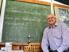 MEMORY LANE: Tennis legend and Blackbutt boy Roy Emerson revists his old school room, now a museum in Blackbutt, Nukku Nook, during a visit in January.