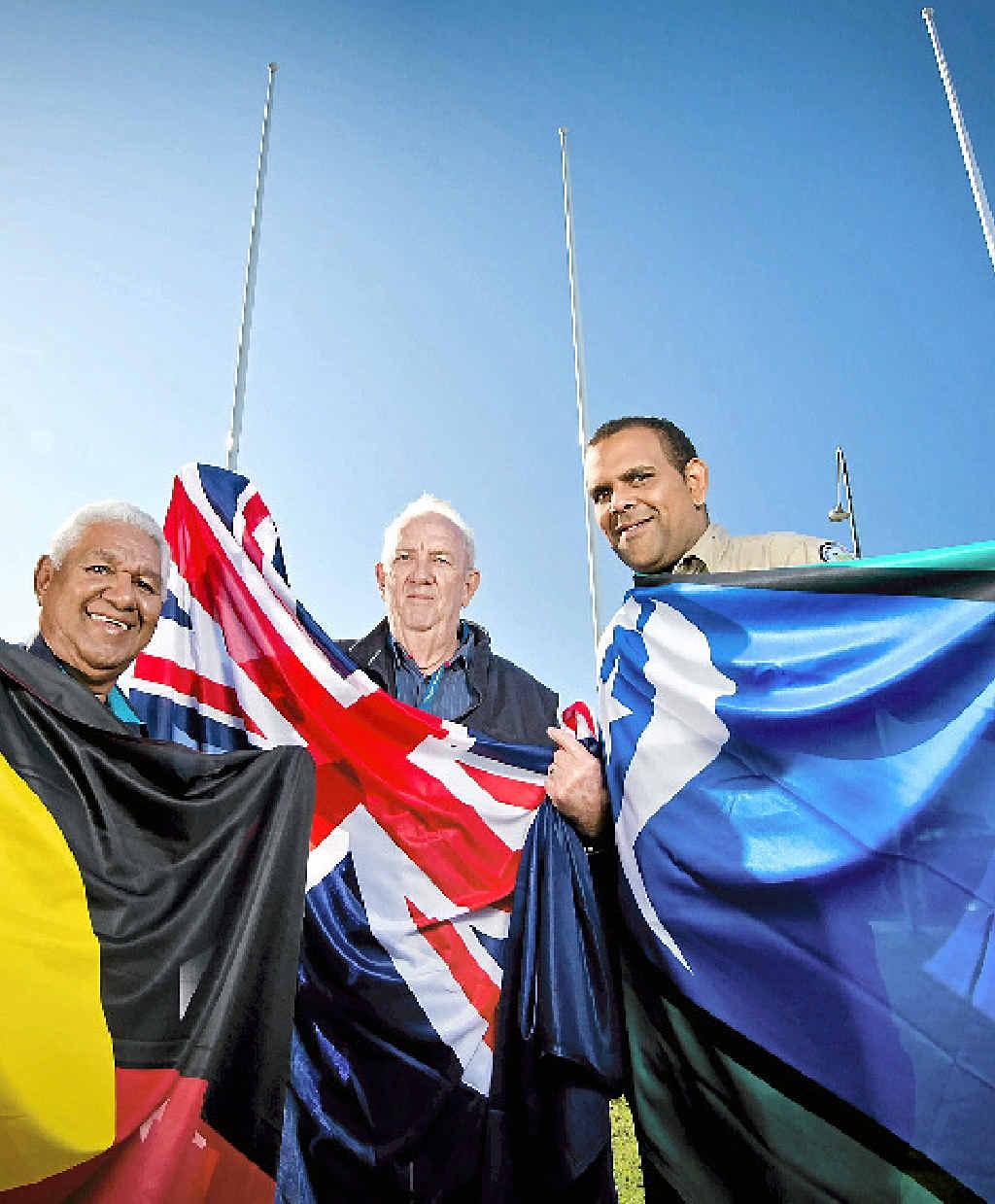 FLYING HIGH: Gooreng Gooreng Aboriginal elder Richard Johnson, Rotary Club of South Gladstone director Bruce Hunt and Torres Strait Islander Symeon Marou raise the three flags at Gallipoli Place.
