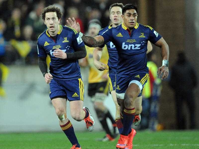 Highlanders' Marty Banks, left, receives a pat on the back from Malakai Fekitoa after kicking a drop goal against the Hurricanes in the Super Rugby final match at Westpac Stadium, Wellington, New Zealand, Saturday, July 04, 2015.