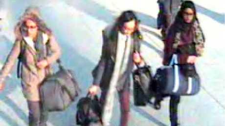 CCTV still of 15-year-old Amira Abase, left, Kadiza Sultana,16, center, and Shamima Begum, 15, walk through Gatwick airport before travelling to Syria