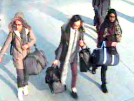CCTV still of 15-year-old Amira Abase, left, Kadiza Sultana,16, center, and Shamima Begum, 15, walk through Gatwick airport before travelling to Syria