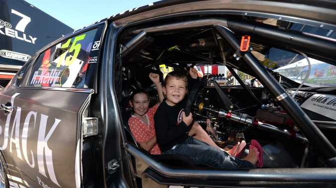 Heidi and Mitchell Overall who are great fans of V8 racing try out Rick Kelly's V8 at North Jacklin Nissan.