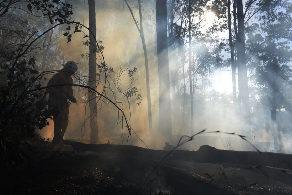 GRASS FIRE: Fire fighters battling fires across the Mackay region as wind increases