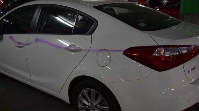 VANDALISED: This car was just one of many vandalised at Dalby Shoppingworld with purple spray paint.