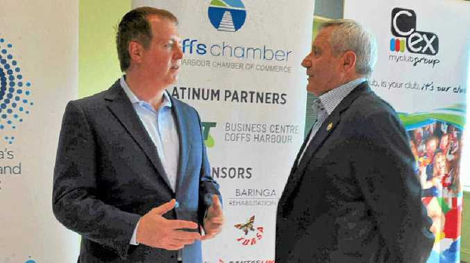 BROADBAND: NBN community affairs manager Darren Rudd and Coffs Harbour Chamber of Commerce president George Cecato discuss the rollout of the NBN.