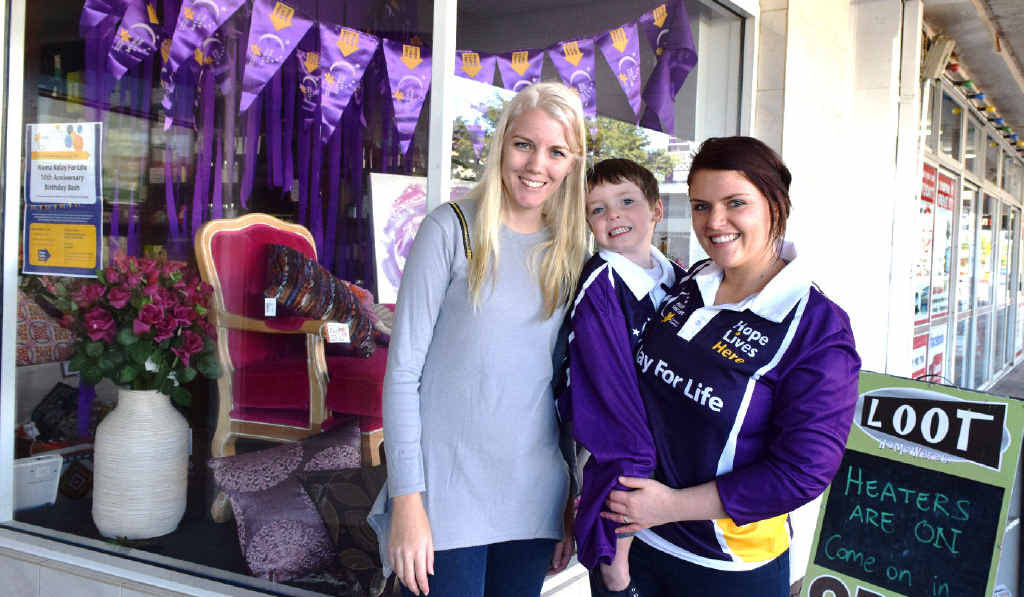 PURPLE POWER: Supporting the Relay For Life Paint The Town Purple campaign is Loot Homewares Roma owner Erin Brumpton with local branch member Lisa Becky and son Tyler.