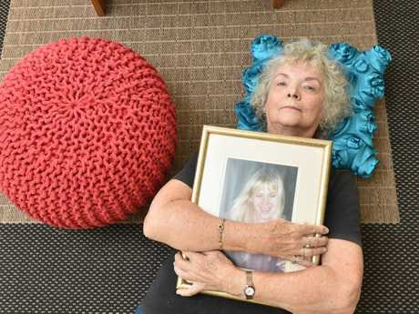 Ligita Sternberg with a portrait of her daughter Ingrid Lester. Photo: Alistair Brightman / Fraser Coast Chronicle