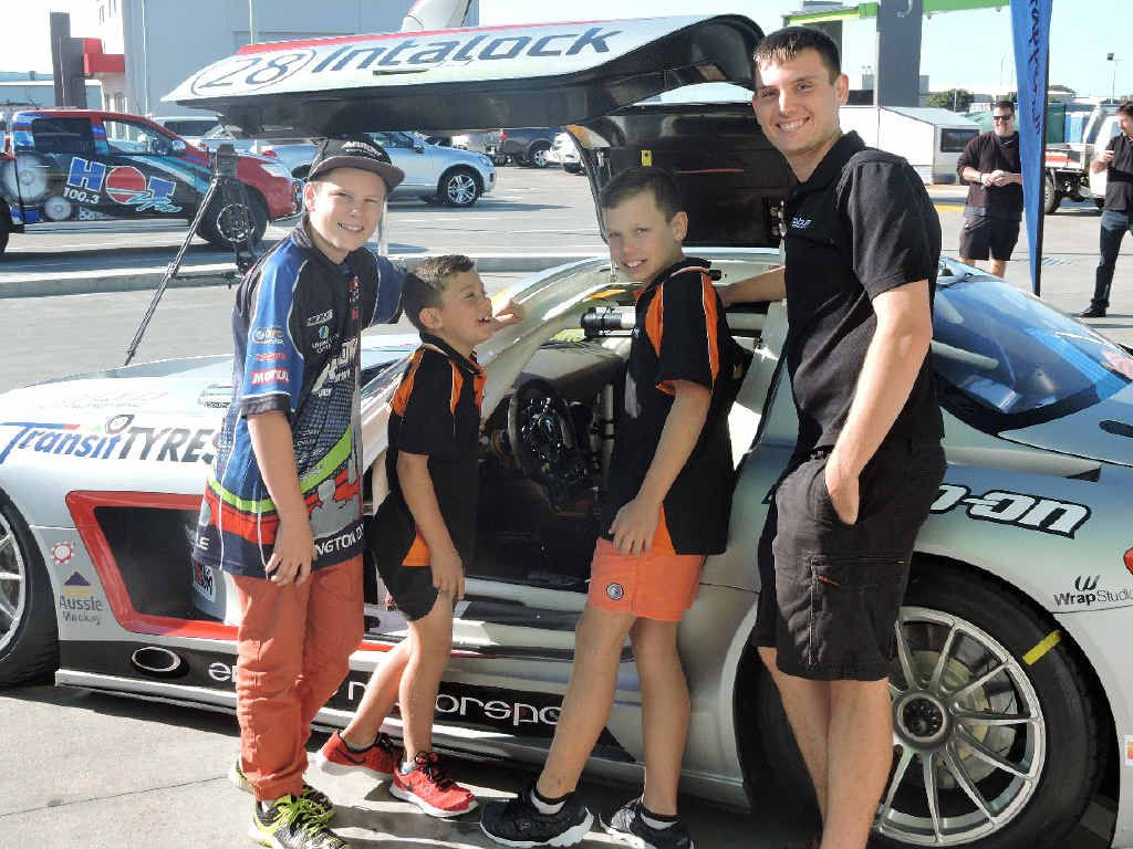 DRIVE BY: Mackay's Erebus Motorsport driver Morgan Haber talks to aspiring kart drivers (from left) Declan Fraser, Dylan LeGarde and Riley LeGarde.