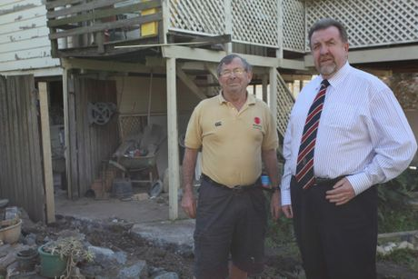 FRANK TALK: Goodna flood victim Frank Beaumont, seen here with Cr Paul Tully, lost everything in the 2011 floods and wants the government to settle a class action case out of court before trial.