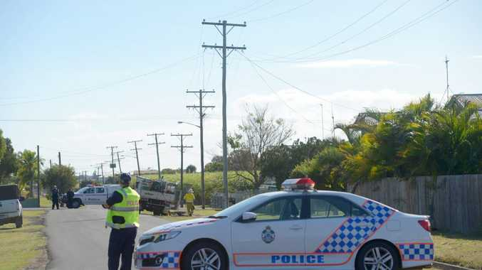 DOWNED LINES: Emergency services and Ergon attend to fallen power lines on Agnes St in North Bundaberg. Photo: Max Fleet / NewsMail