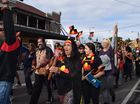 NAIDOC WEEK 2015: Around 250 people got together under grey skies for this year's NAIDOC Week march through Byron Bay. Photo Christian Morrow / Byron Shire News