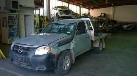 The mangled Mazda BT50 ute from which Logan Johnston, 17, walked with no injuries after it rolled Wednesday morning.
