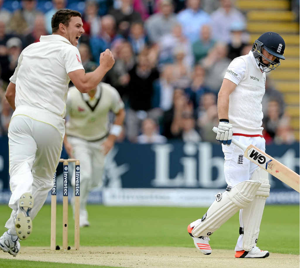 FIRST BLOW: Josh Hazlewood celebrates his debut Ashes wicket – the first of the series – as Adam Lyth walks off dejected at Cardiff.