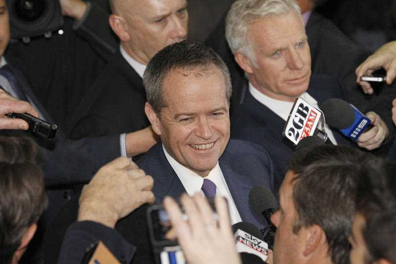 Australian Opposition leader Bill Shorten is surrounded by media as he gives a press conference after his second day of questioning at the Royal Commission into Trade Union Governance and Corruption in Sydney. Thursday, July 9, 2015