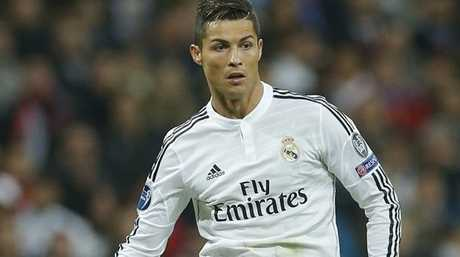 Real Madrid's Cristiano Ronaldo runs with the ball during a Group B Champions League soccer match between Real Madrid and Liverpool at the Santiago Bernabeu stadium in Madrid, Spain, Tuesday Nov. 4, 2014. (AP Photo/Paul White)
