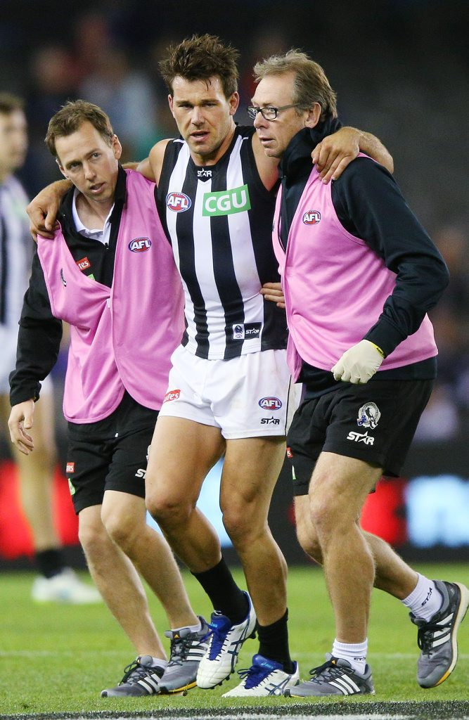 MELBOURNE, AUSTRALIA - MARCH 21: Levi Greenwood of the Magpies is carried off after injuring his left leg in a tackle on Jarrad Grant of the Bulldogs during the NAB Challenge AFL match between the Western Bulldogs and the Collingwood Magpies at Etihad Stadium on March 21, 2015 in Melbourne, Australia. (Photo by Michael Dodge/Getty Images)