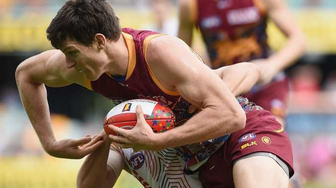 Justin Clarke of the Lions is tackled by Luke Dunstan of the Saints during the round 9 AFL match between the Brisbane Lions and St Kilda Saints at The Gabba in Brisbane, Sunday, May 31, 2015. (AAP Image/Matt Roberts) NO ARCHIVING, EDITORIAL USE ONLY.