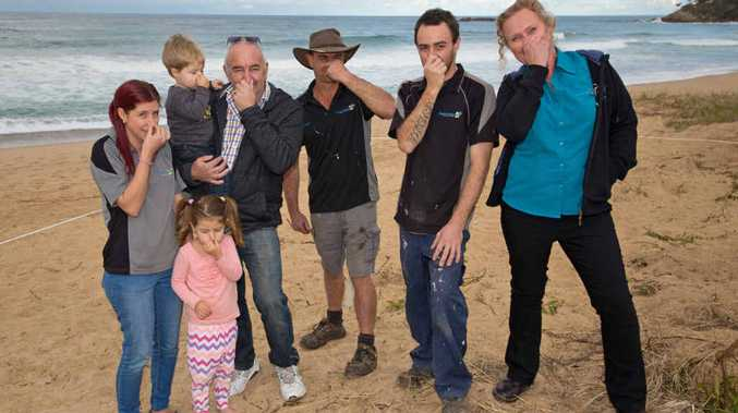 ON THE NOSE: Concerned about the smell of a buried whale near Sapphire Beach Holiday Park are Charmaine, kids Chloe and Bailey, Dave, Terry, Luke and Sam.