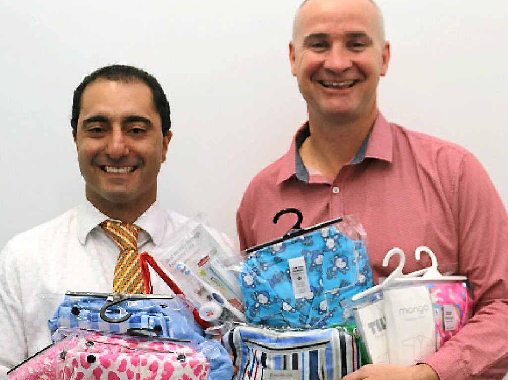 FOR KIDS: Cr PJ Sobhanian and Gladstone MP Glenn Butcher donate pyjamas.