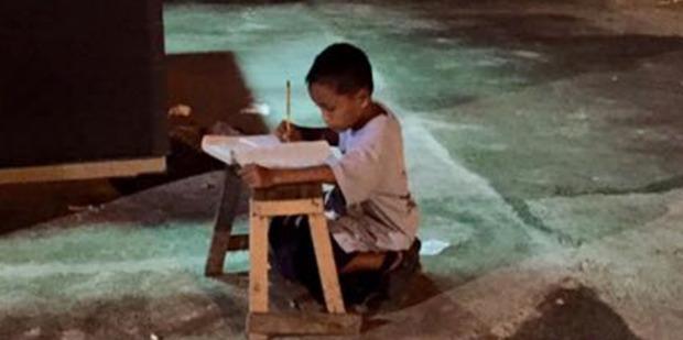 Daniel Cabrera uses light from a McDonald's to do his homework. Photo / Facebook