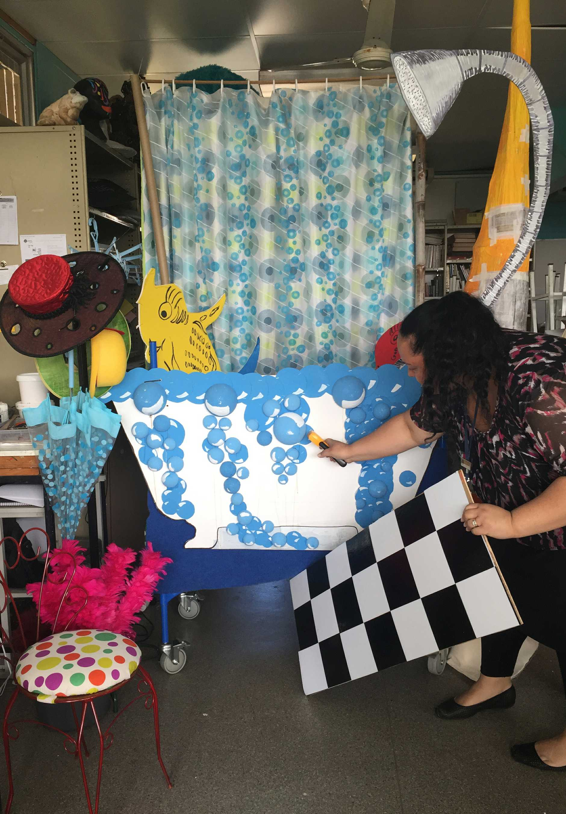 Cristie Lolo working on the set design for Seussical the Musical