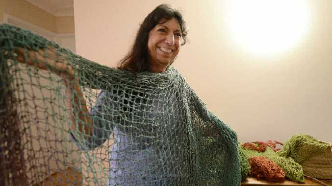 HERITAGE HONOURED: Indigenous artist Glenda Nicholls with her throw net and other handwoven items she has created, leading to being short-listed for the 2015 Victorian Indigenous Art Awards.