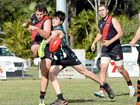 SHOT: Bay Power's Damon Oakley hits Hervey Bay Bomber James Hickey as he kicks during the local derby on Saturday.