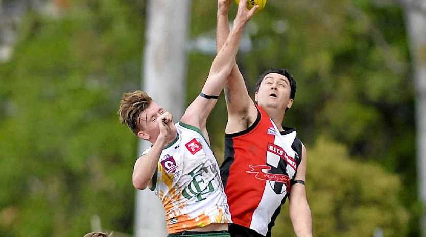 Gladstone Reserves' Jay Winnell contests the ball against BITS ruckman Anthony Everitt.