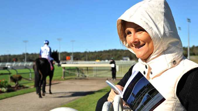RUGGED UP: Alyssa Cook keeps warm at Corbould Park yesterday.