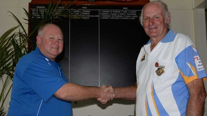 MERITIORUS SERVICE: Greg Caullex Presents Geoff Hicks with a service award at the Moore parks bowls club. Photo: Paul Donaldson / NewsMail