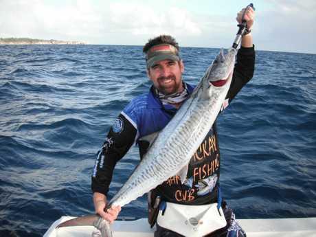 TOURNAMENT FISH: Mackay Game Fishing Club's Craig Breadseel with a Spanish mackerel caught off Mackay