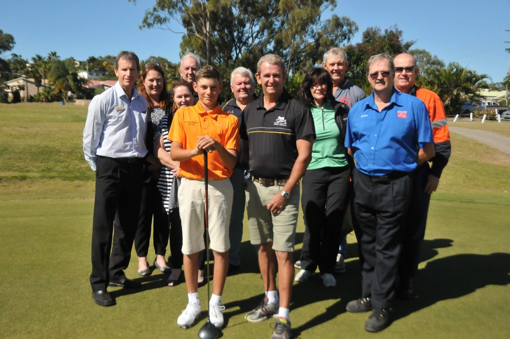 Ryan Stitt with his coach Dion Hayne pictured with businesses Allied Pickfords, Ray White, Rotary of South Gladstnoe and Busteed Upholstery, who have all supported his trip to America. Photo Tegan Annett / The Observer