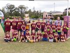 The happy group of youngsters, with team mascot and program supporters, at Broncos Headquarters in Red Hill. Photo contributed