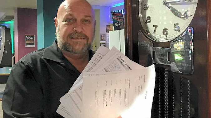 BIG EFFORT: Maryborough RSL hospitality manager Stephen Yeates with a handful of the resumes he received ahead of the business's speed recruiting event.