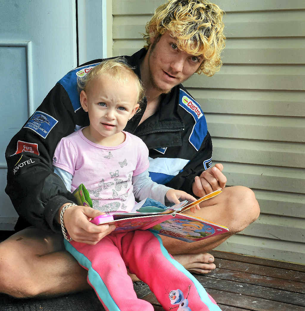 FAMILY'S HEARTACHE: Raymond Vassie with his two-year-old sister Zeva Green on the family's doorstep where the family's pet kitten Sabor (pictured inset) was snatched and mauled by two dogs last week.