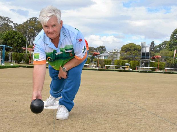 HOOKED: Kingaroy's John Lacey on the right foot for a successful roll down the green.