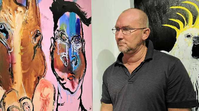 Stephen Homewood with his artwork Extinct Australians.