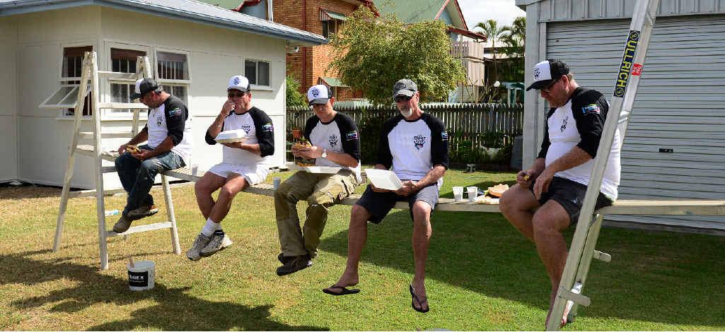LUNCH BREAK: Berger Paint For a Mate volunteers enjoy a well-earned lunch break.