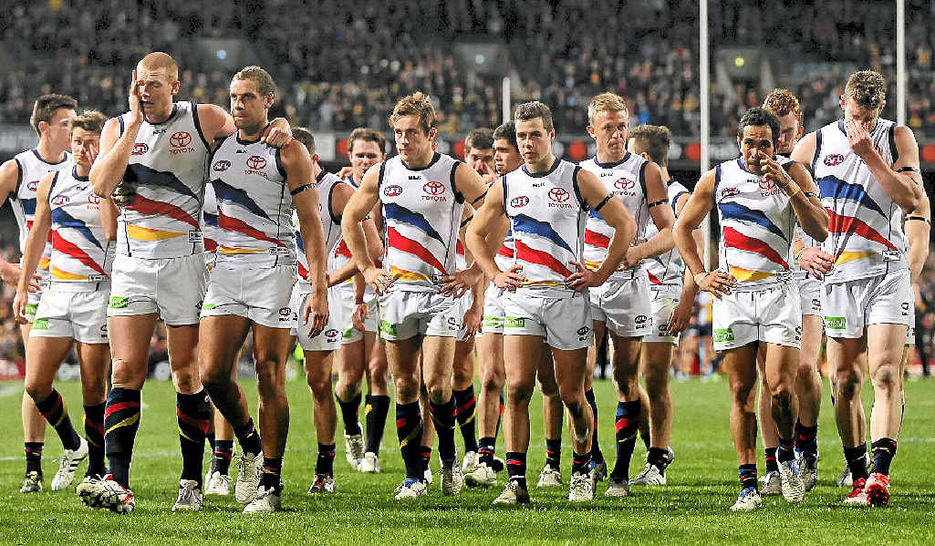 Emotional Crows players walk from the field after being defeated by the Eagles on Saturday night.