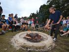 DAMPER LESSONS: Students from Evans River K-12 had damper for morning tea after watching it cooked over a fire as part of their NAIDOC celebrations before the school holidays. Photo Samantha Elley / Express Examiner