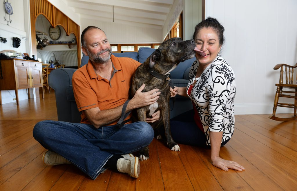 Kev and Chris Thomas have been reunited with their dog, Bruce. Photo: Rob Williams / The Queensland Times