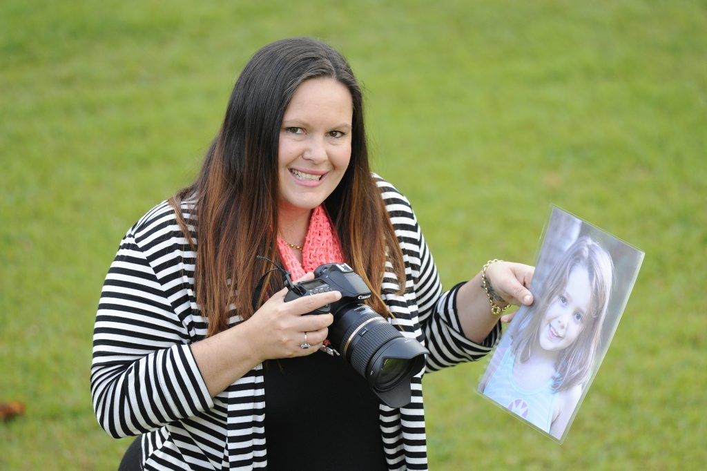 CONFIDENCE BOOST: Renae Barnes' experience with photography made her realise the lack of self confidence among young girls. Now, she is on a quest to change that. Here she stands with a photo of her daughter.