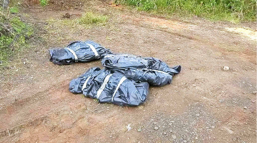 ILLEGAL: Lismore City Council officers found these dumped packages, containing asbestos, at the quarry on Gwynne Rd.