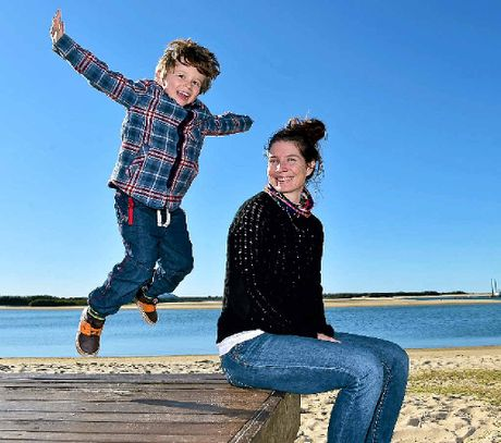FUN IN THE SUN: Tully, 4, and Meghan Hopgood, of Eudlo, soak up the sun in Cotton Tree as the cold winds continue.