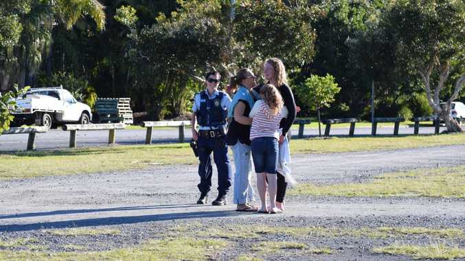 RESCUE: Billy Swayn from Victoria is re-united with his mother and sister after being rescued from rocks below the Byron Lighthouse by the Wespac Rescue Helicopter. Photo Christian Morrow / Byron Shire News