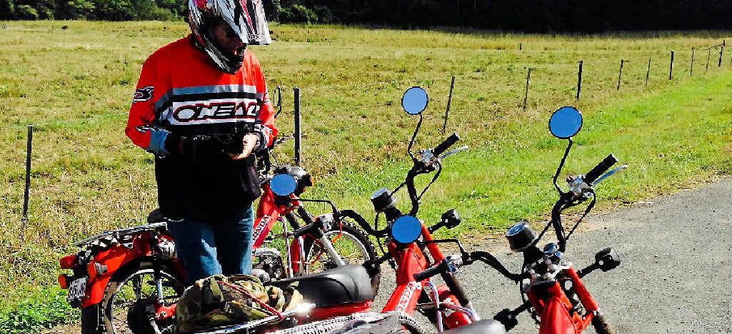 ROAD WARRIOR: Steve Brooks checks his bike before a pre-safari run.